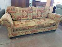 Large vibrant patterned fabric two seater sofa