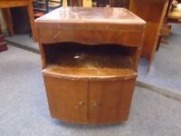 dark wood bed side cabinet cupboard and drawer.