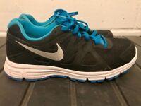 Size 5 women's Nike running shoes