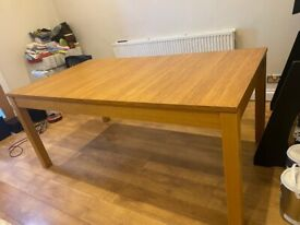 Extending wooden table