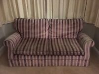 Lovely Laura Ashley large two seater sofa. Pink and purple tones.