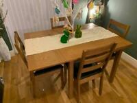 Extendable oak table with 4 chairs