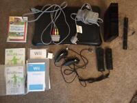 Nintendo wii (black) with wii fit board and wii sports game