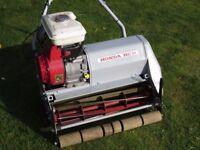 Honda HC 21 self propelled cylinder mower.