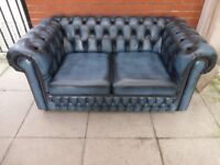 A Blue Leather Chesterfield Two Seater Sofa