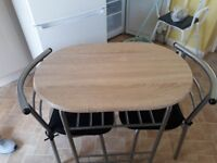 Small light cedar table and 2 chairs as new