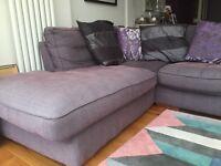 Comfiest grey L shape sofa. Fits 6 adults comfortably. Smoke and pet free home.Cushions &footstool