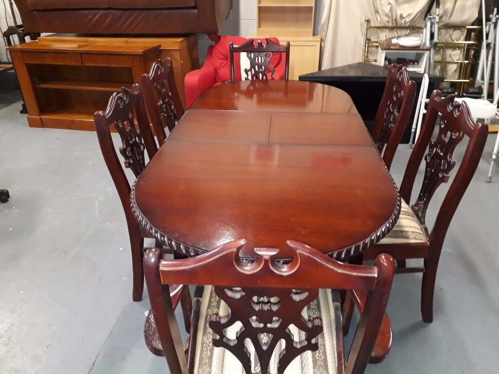 Beautiful large extending table and 4 chairs and 2 carvers. Delivery can be arranged if required