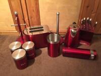 Red coloured kitchen set kettle toaster storage pots etc