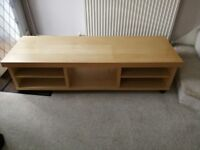 Wooden TV stand for sale.