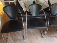 4 used Faux Leather & Chrome Black Modern Dining Chairs