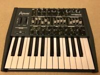 Arturia MiniBrute monophonic analogue synthesiser with stand