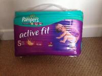 2 packets - size 5 Active Fit Pampers Nappies