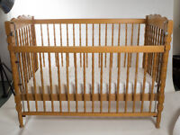 """Wooden cot light wood in colour with matress. Bed base is 4 foot long by 23"""" wide."""