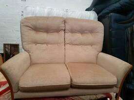 Material two seater sofa for sale clean condition