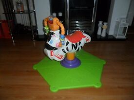 fisher price toddler bouncing and spinning zebra