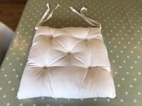 Set of 6 cream cushion pads. As new condition.