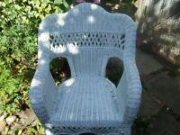 A lovely little white garden or patio wicker chair