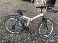2 Folding mountain bicycles with 18 gears; one used, one new in box