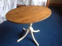 Oval waxed top side table