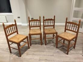 4 Pine Chairs from the 1980's with wicker style sests