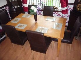 "Table and 6 chairs in light oak . Table size 63""L X 35 1/2 W X 29 3/4H + 6 Chairs in brown"