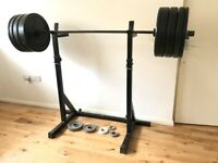 Serious about weight-lifting? Set of weights, with squats-stand and Olympic-style bar for home gym.