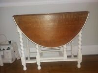 Small oak dining table with waxed top and legs finished in Farrow and Ball paint.Seats four.