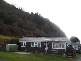24 August chalet / caravan with sea view to let on Clarach Bay Holiday village Aberystwyth Wales