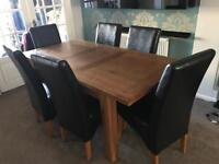 Solid oak extendable dining table with 6 brown leather chairs (Harveys)