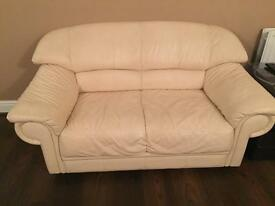 Cream soft leather two seater sofa