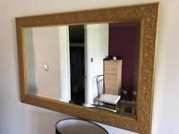 Ornate antique gold mirror