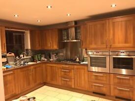 Walnut kitchen with AEG Appliances
