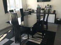 Black Gloss Extending 6 seater Table
