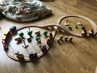 Wooden train track and lots of trains