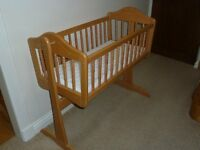 Mama and Papas swinging crib - Great condition. Includes Brand new unused mattress.