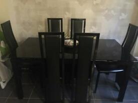 Black noir extending dining table with 6 black\chrome upholstered chaired