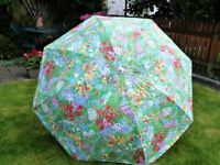 A FLORAL GARDEN UMBRELLA. In Good Condition PLEASE NOTE:- NO Base or Stand is Included