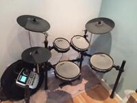 Alesis dm8 pro electronic drum kit.