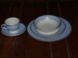 Royal Doulton light blue and white 20-piece dining set.