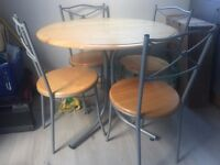 round dinning table with 4 chairs Birch colour with Grey metal legs