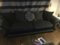 Black leather with grey fabric couch, great condition no rips tears or signs of wearing