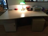 Large desk with filing cabinets and drawers