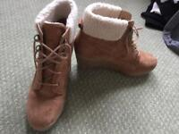 Brown faux swede and fur heeled boots