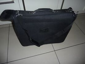 Suit case for carrying your suits and clothes you want to keep unfolded.