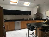 Solid Oak Kitchen with black granite worktop