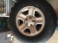 5 Jeep rims and tires
