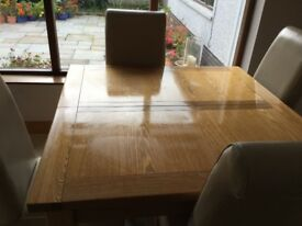 Oak dining table and 4 leather high back chairs