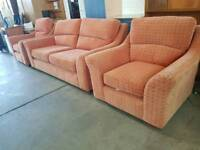 Red fabric two seater sofa with 2 chairs