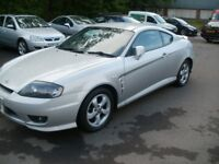 Hyundai 1.6 coupe on 06 plate.